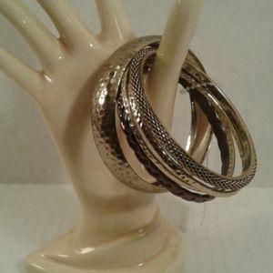 Set Of 6 Bangle Bracelets Gold in color
